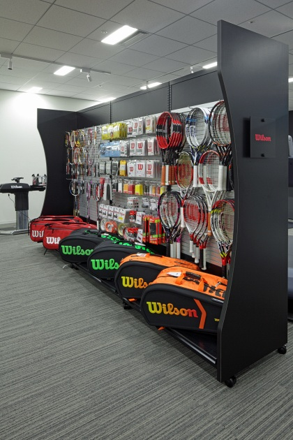 Amer Sports Japan, Inc./【Showroom area】Single-sided display cases display tennis goods.