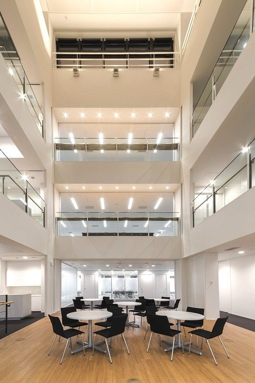 "Origin Electric Co., Ltd./【Ecovoid (Technical Head Office)】The four-story open-ceiling space serves as an ""interaction space"" connected to all works spaces."