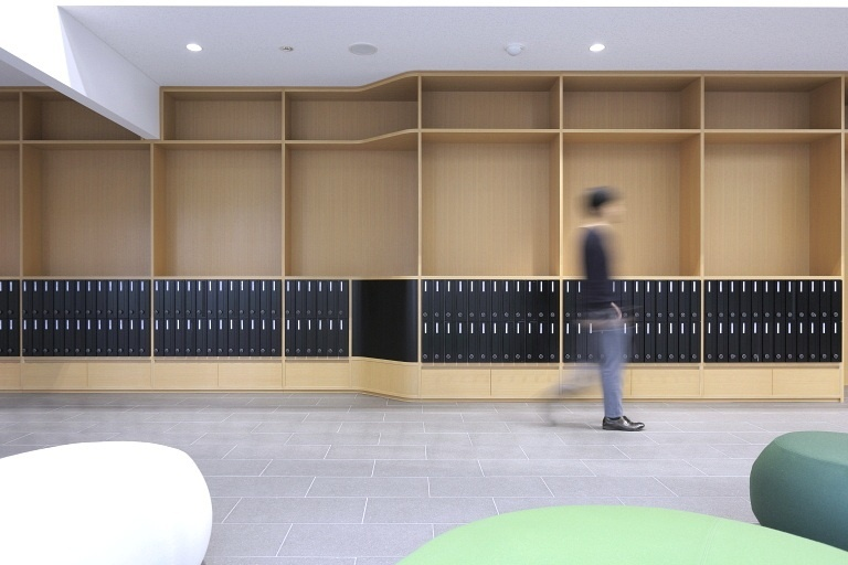 Sendai Oroshisho Center/【Culture lounge】In addition to functioning as post office boxes, the wall storage also serves as a bulletin board for displaying posters to people passing by.